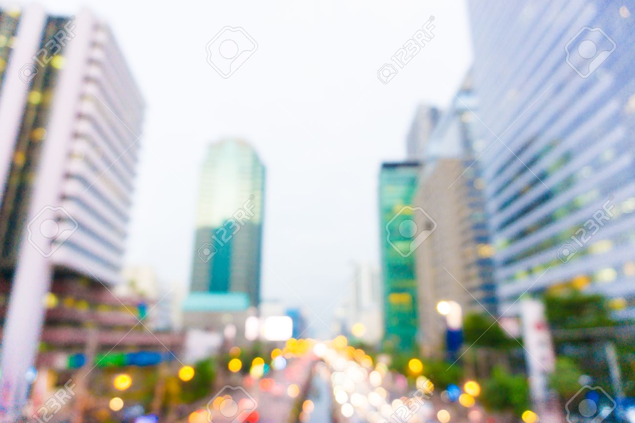 Background image blur - Abstract Urban Background With Blurred Buildings And Traffic City Blur Background Stock Photo