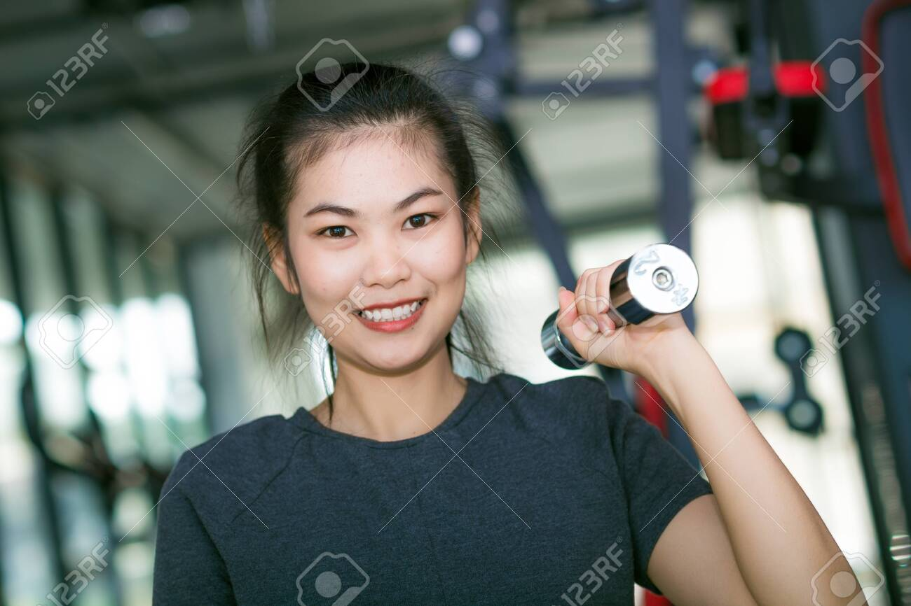 Body Of Young Fit Woman Lifting Dumbell Women Working Out With Stock Photo Picture And Royalty Free Image Image 52821250 Fitness photography fit women bikinis swimwear portraits models olympus bodybuilding strong. 123rf com