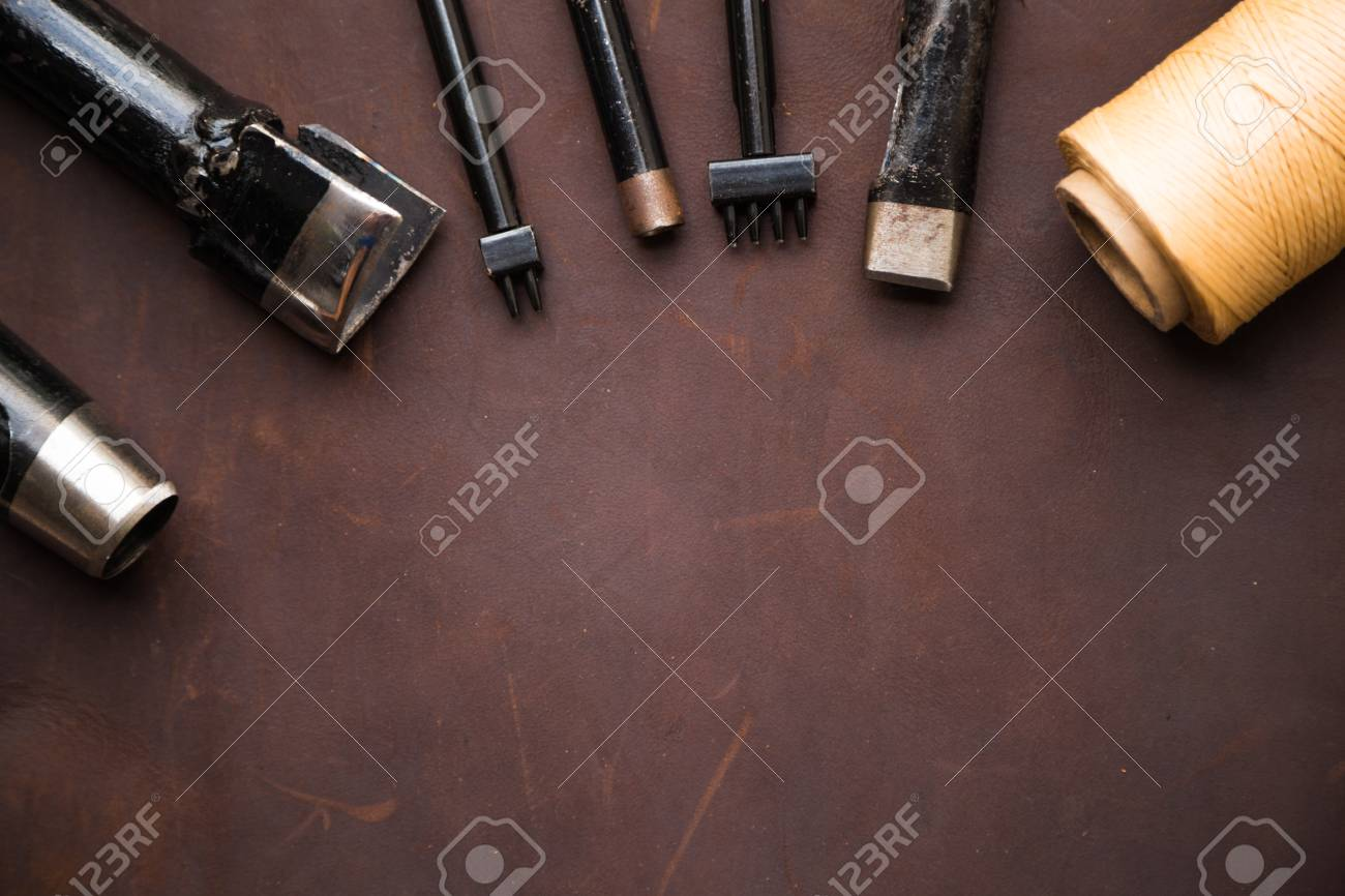 Background of leather craftsmanship with tool for handmade product - 64910046
