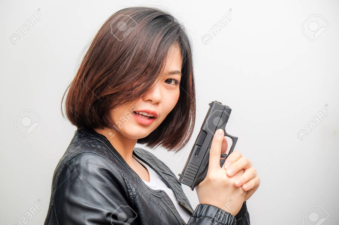 Beautiful Asian Detective Women Target Practicing With Gun Sexy Stock Photo Picture And Royalty Free Image Image 98028713