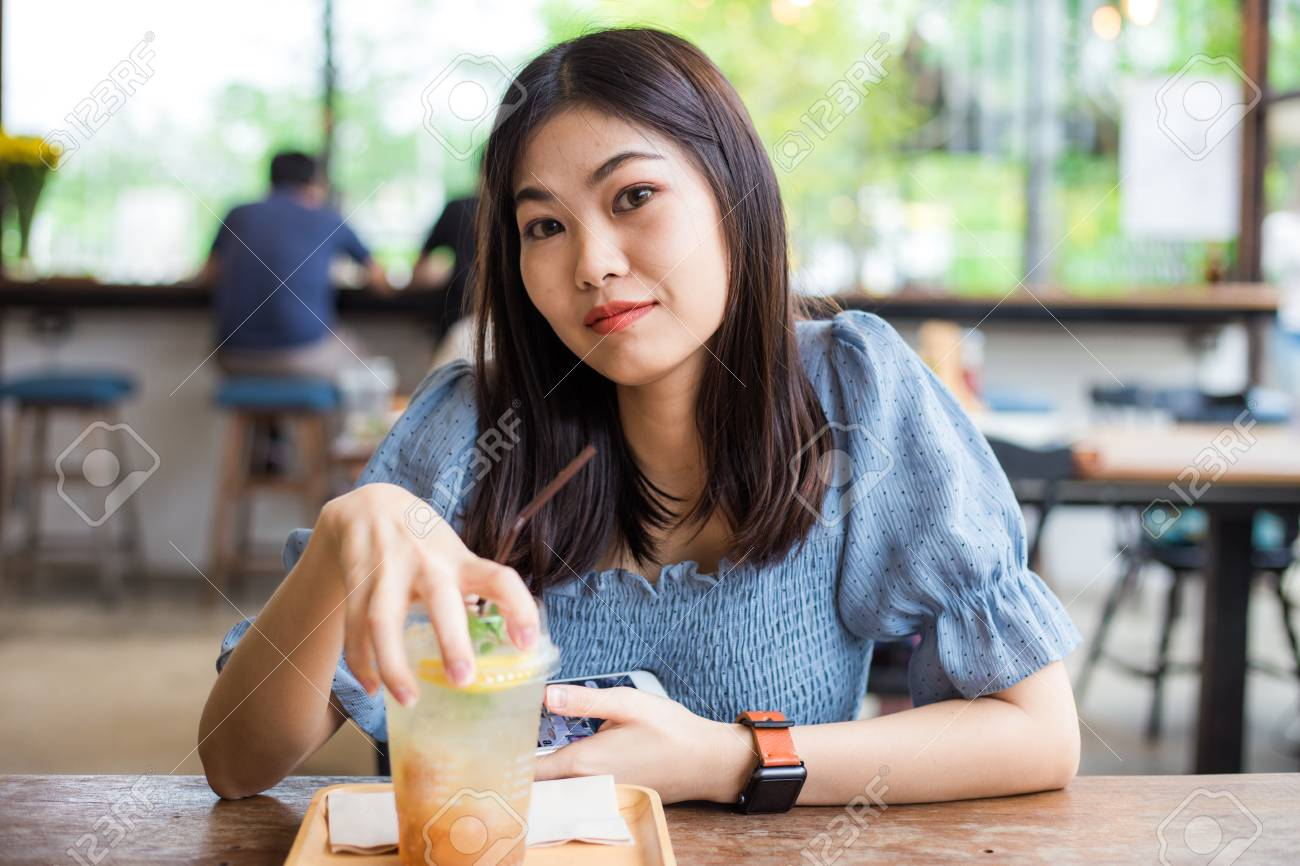 Attractive Asian Women Sitting On Wood Table In Cafe Happy Women Stock Photo Picture And Royalty Free Image Image 106838168