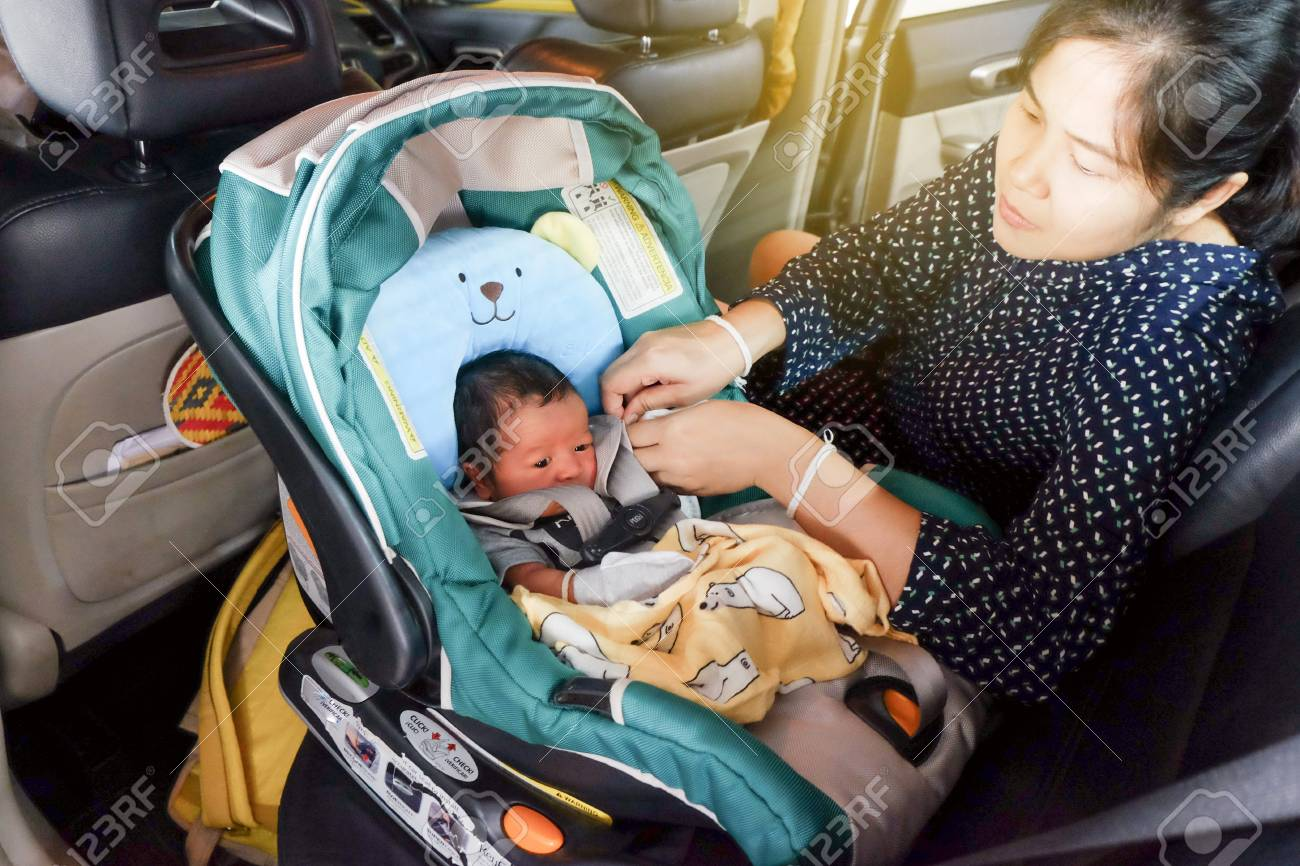Picture of: Mom With Infant Child Boy Inside Savfty Car Seat Go To Hospital Stock Photo Picture And Royalty Free Image Image 125201763
