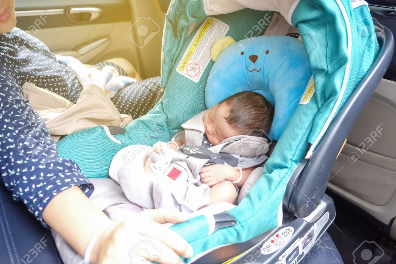 Picture of: Mom With Infant Child Boy Inside Savfty Car Seat Go To Hospital Stock Photo Picture And Royalty Free Image Image 125111012