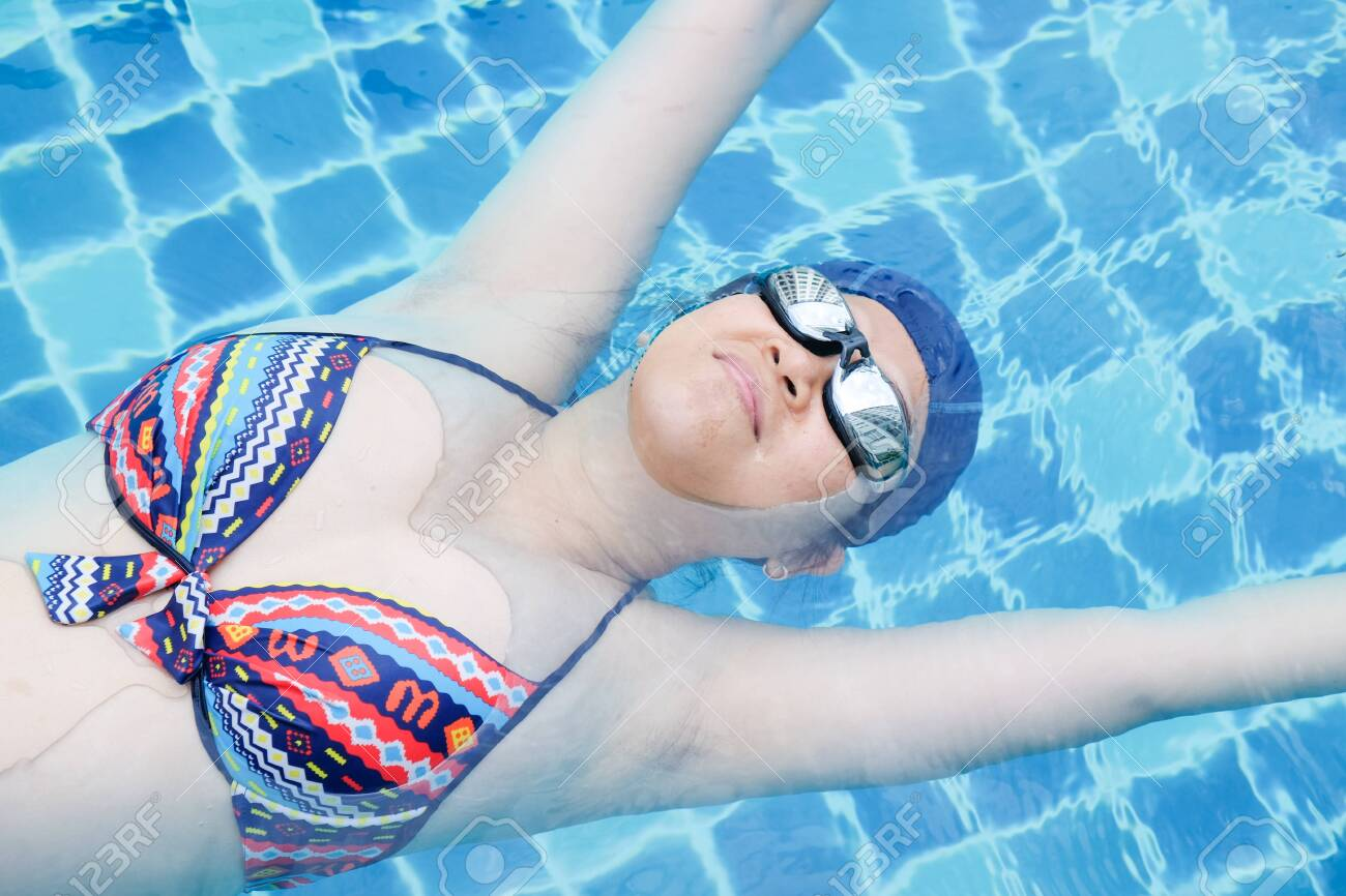 Pregnant women exercise swimming in pool, Relaxtion women