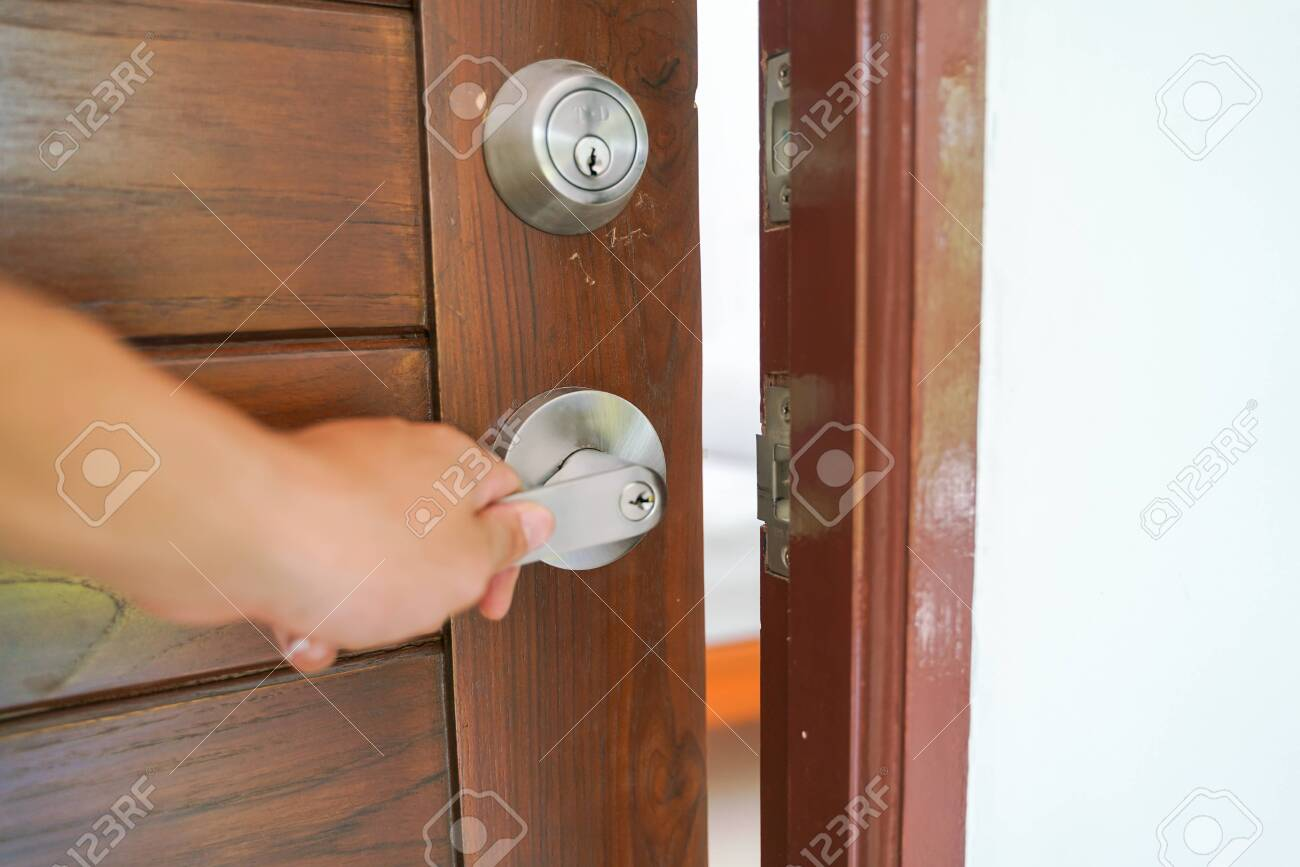 Hand Open Wooden Door Knob Show Inside Modern Bedroom Interior Stock Photo Picture And Royalty Free Image Image 143258880