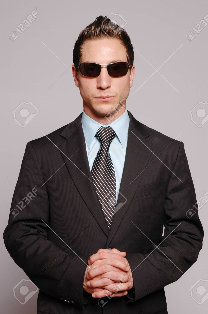 a businessman is posing against gray background Stock Photo - 2078915