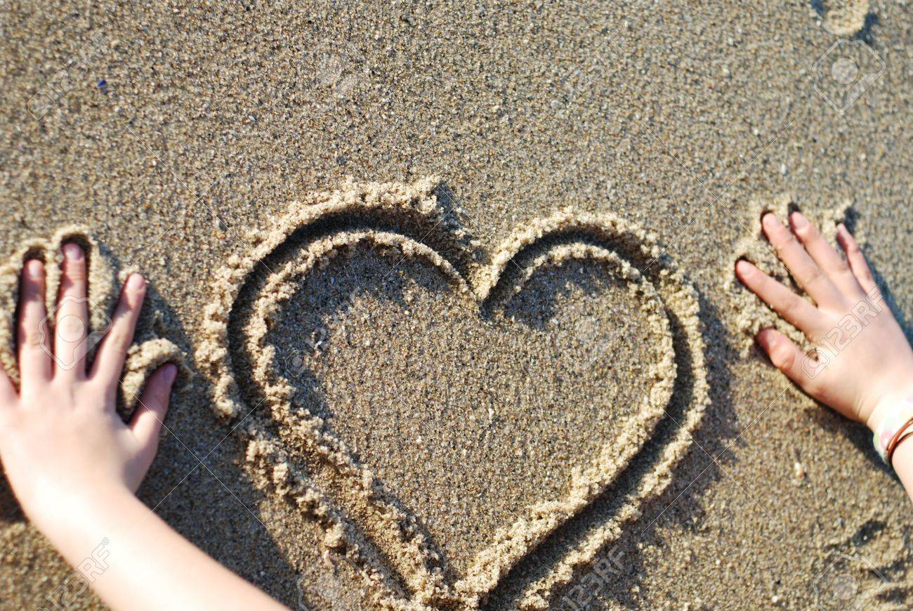 Heart Figure Drawn On The Beach Depicting Love Stock Photo