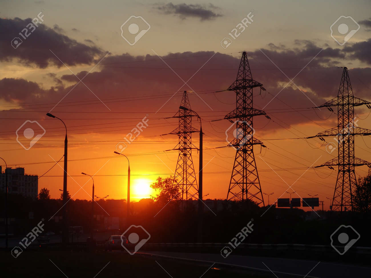 An urbanistic landscape at evening with a highway and power poles Stock Photo - 1448351