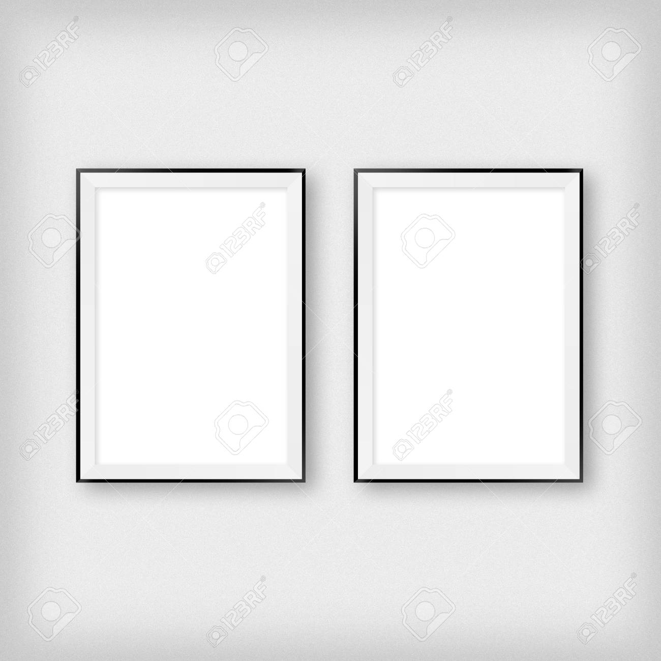 Gallery interior with two empty frames on wall - 121909949