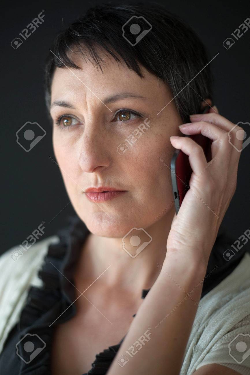 Beautiful Older Woman With Short Brown Hair And Eyes Talking Stock