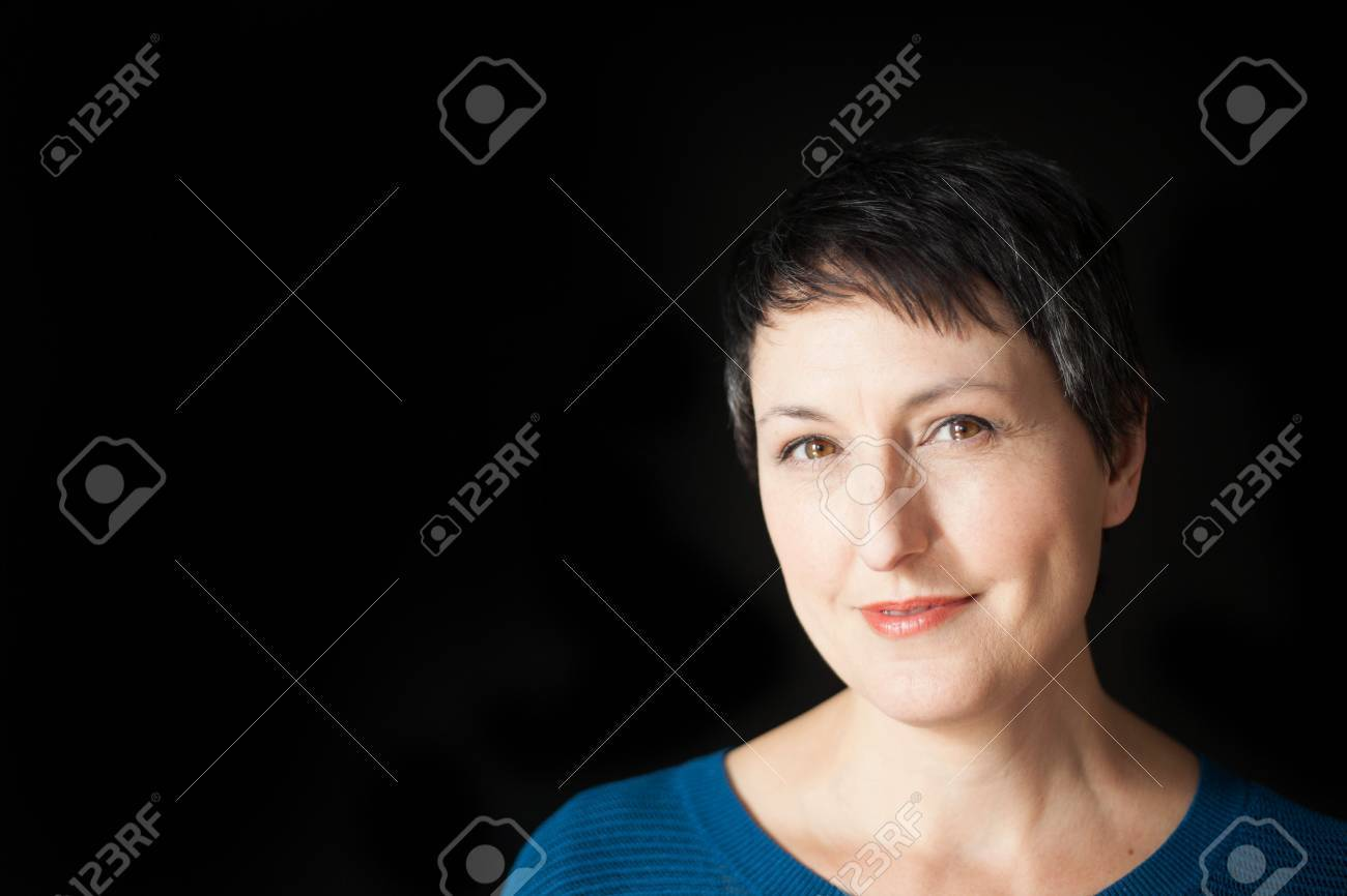 Beautiful Older Woman With Short Brown Hair And Eyes On A Black