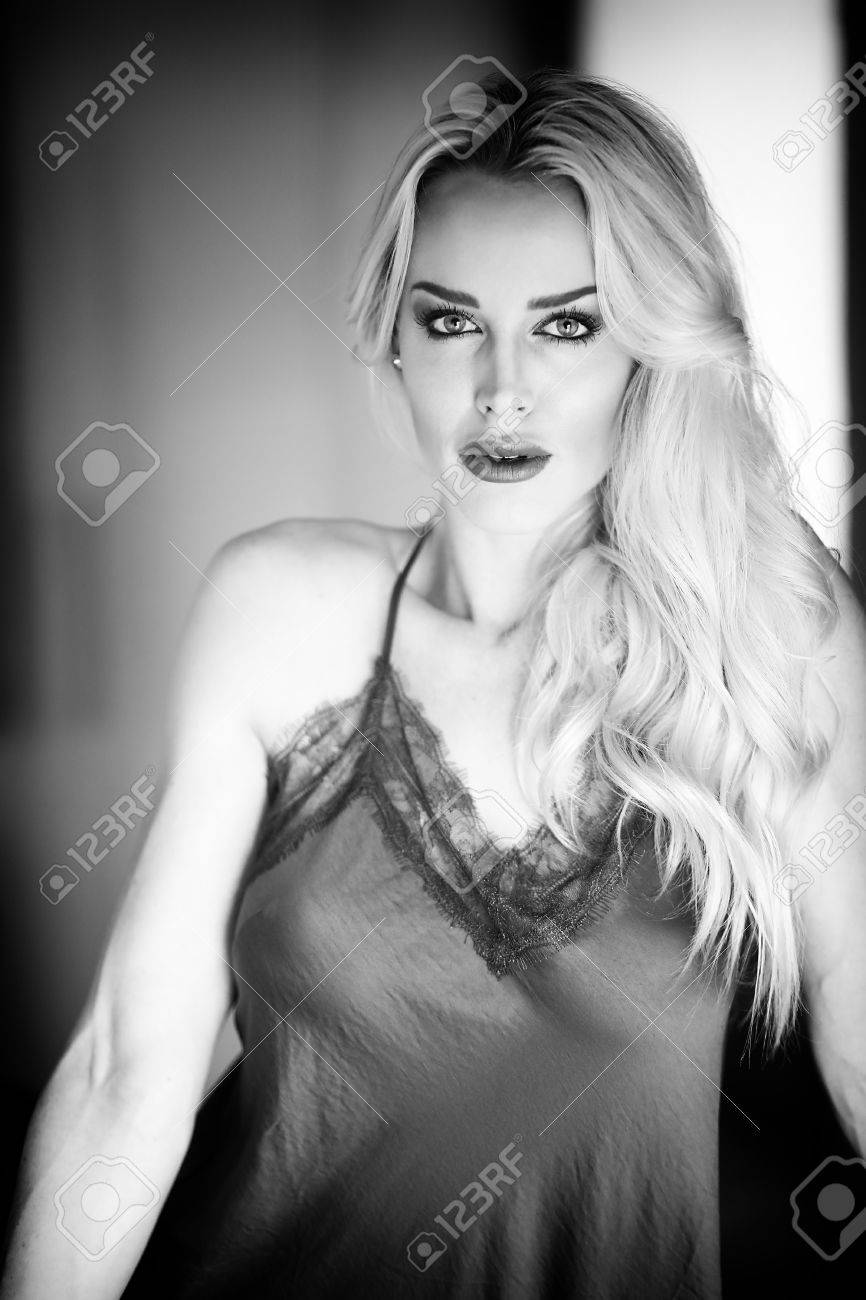 b8ec6053c3 Photo black and white photo of a very attractive blonde woman wearing dark  gray silk lingerie