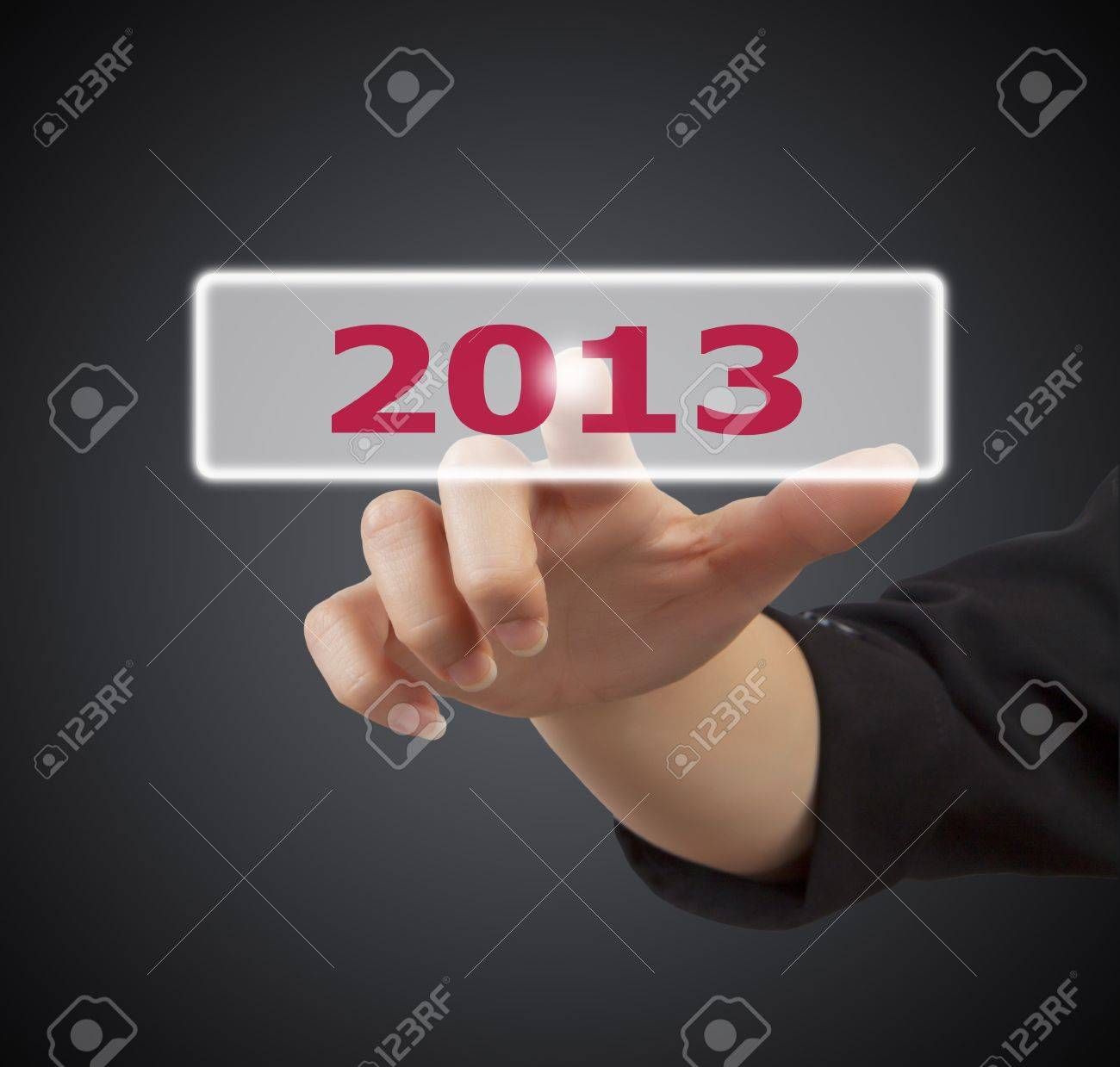 woman hand touching button 2013 keyword, on gray background Stock Photo - 15824412