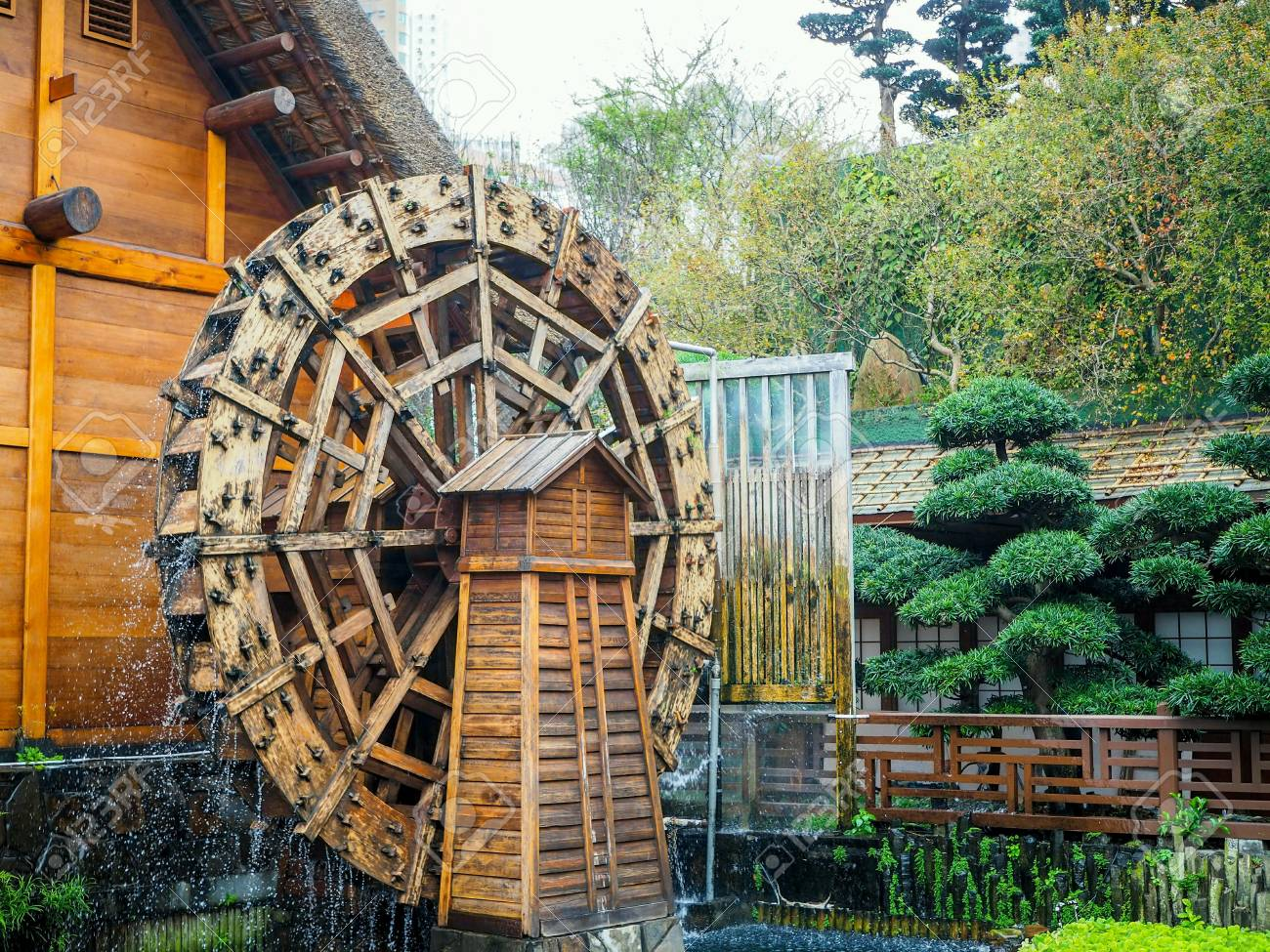 Water turbine at japanese garden , with warm and fresh atmosphere