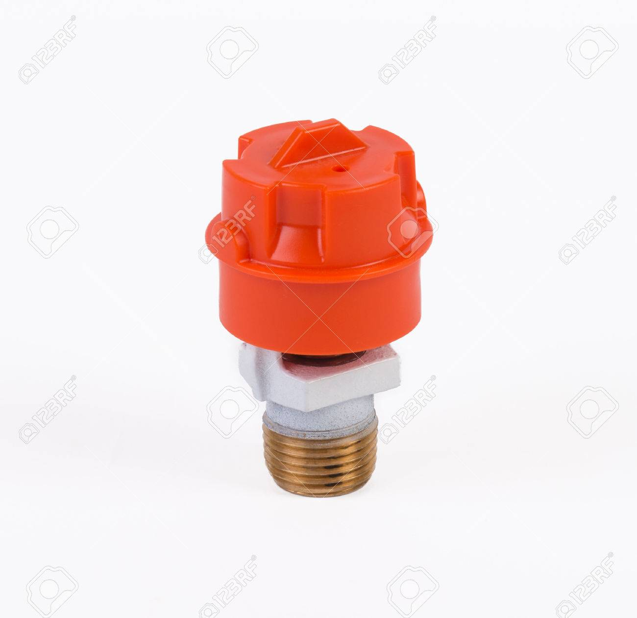 White pendent sprinkler with cap standing upright on white