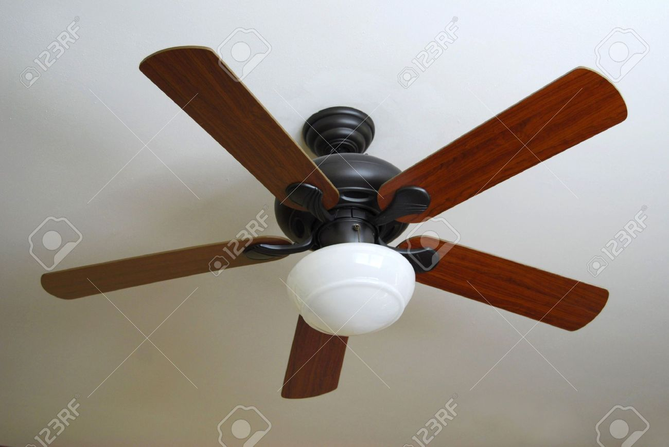 Designer Ceiling Fans Part - 49: A Modern Ceiling Fan, Installed On A Textured White Ceiling. Stock Photo -  2900271