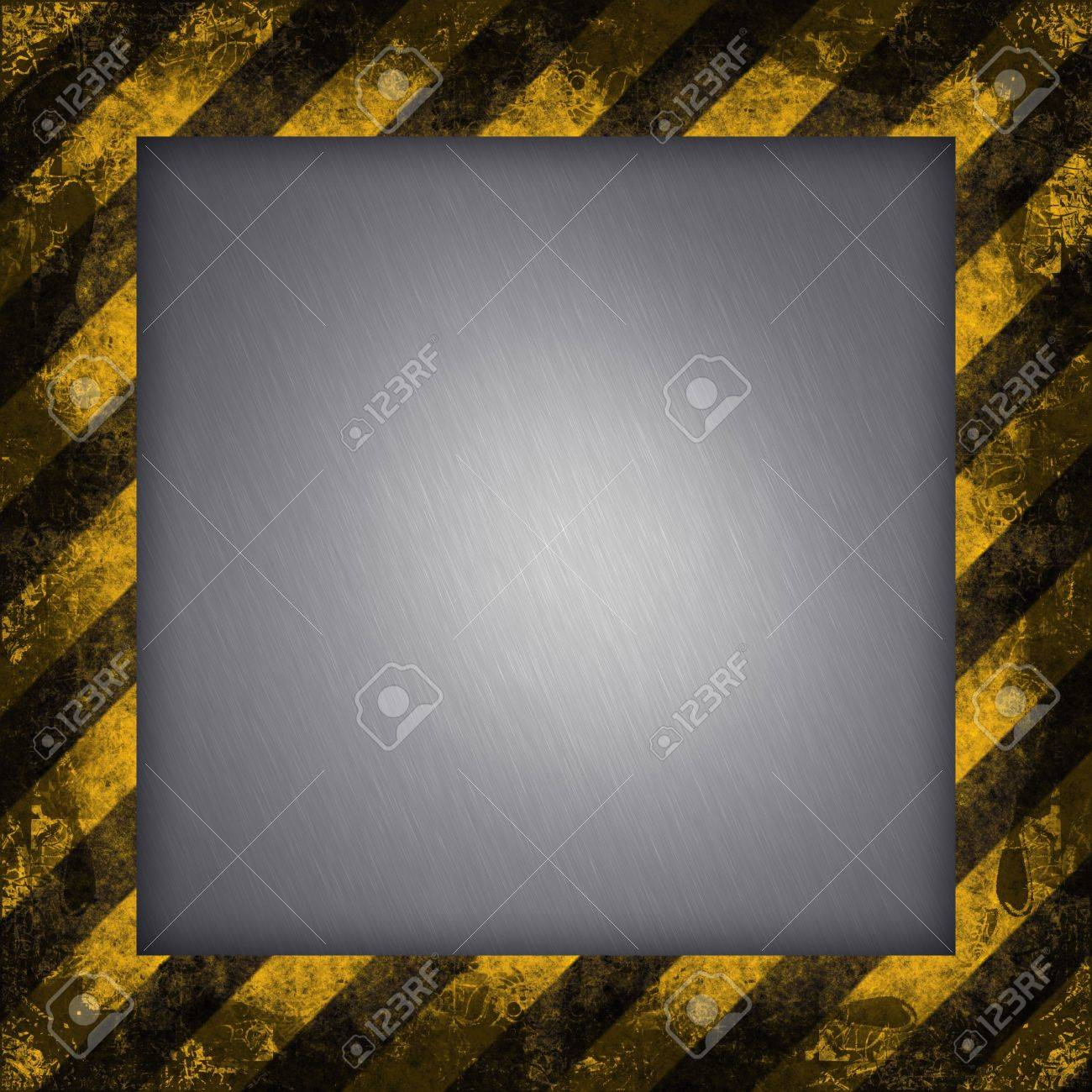 A diagonal hazard stripes border.  The inner part of the frame is brushed aluminum. Stock Photo - 3174435