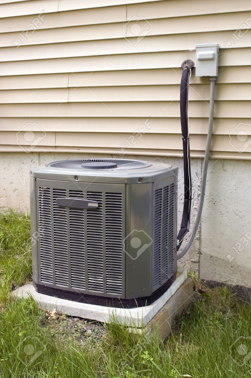 a residential central air conditioning unit sitting outside a home stock photo 3202590 - Central Air Conditioning Unit