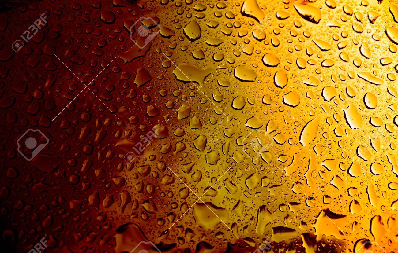 A macro of some water condensation on a glass full of amber colored beer. Stock Photo - 3352299
