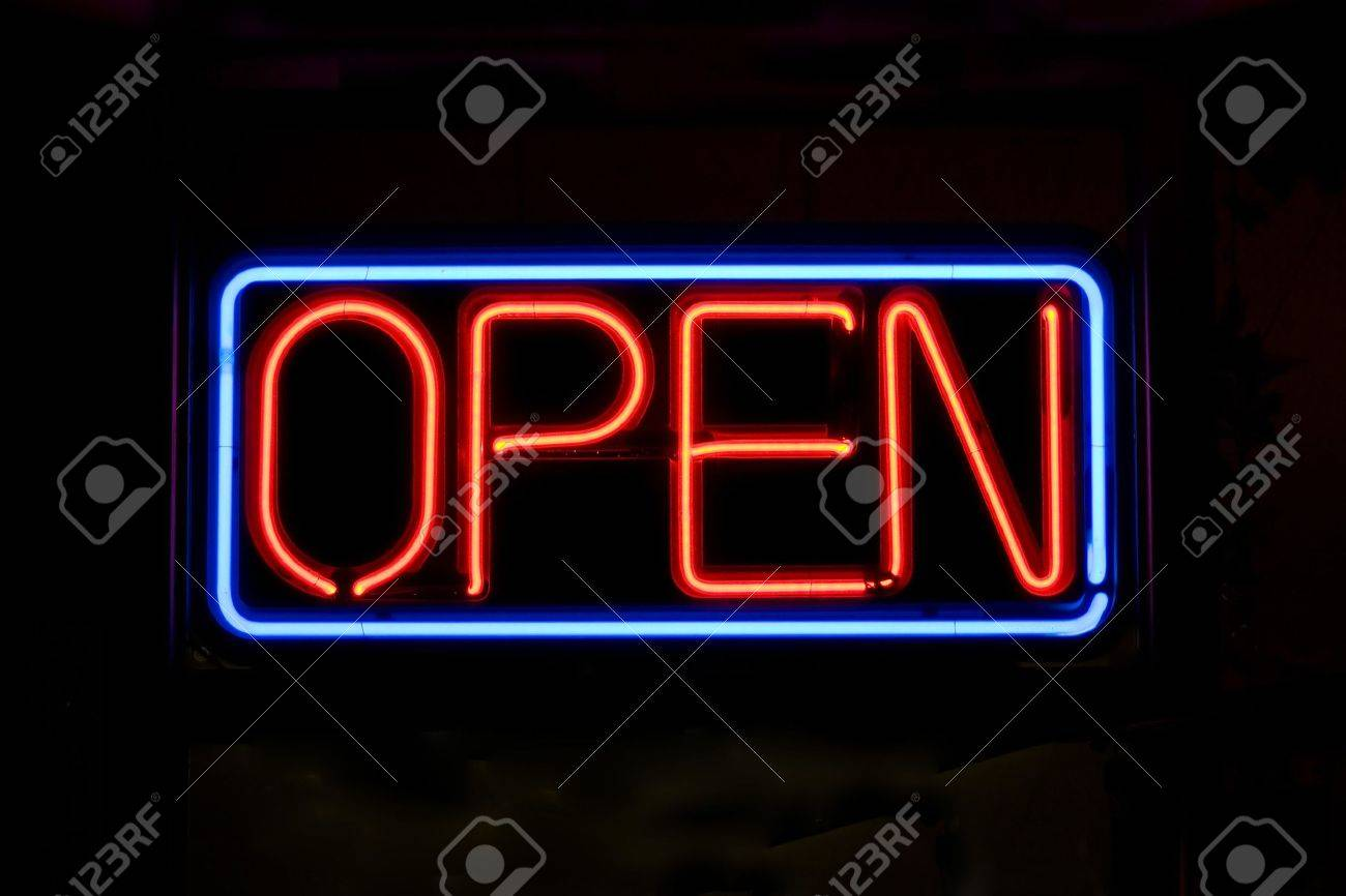 A neon OPEN sign glowing red in the window of a restaurant. Stock Photo - 3682621
