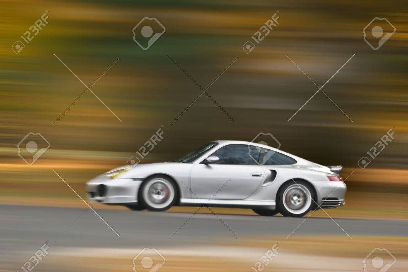 A modern sports car speeding along the road with a motion blur effect. Stock Photo - 3818030