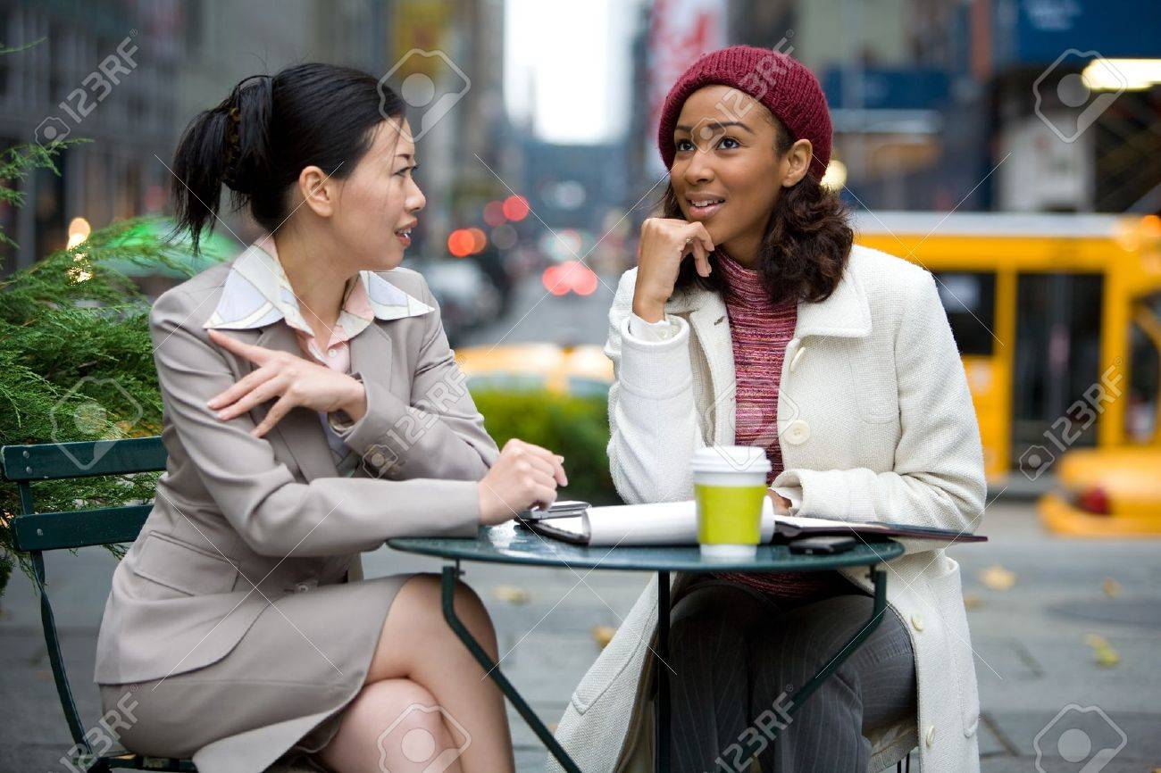 Two business women having a casual meeting or discussion in the city. Stock Photo - 4463837