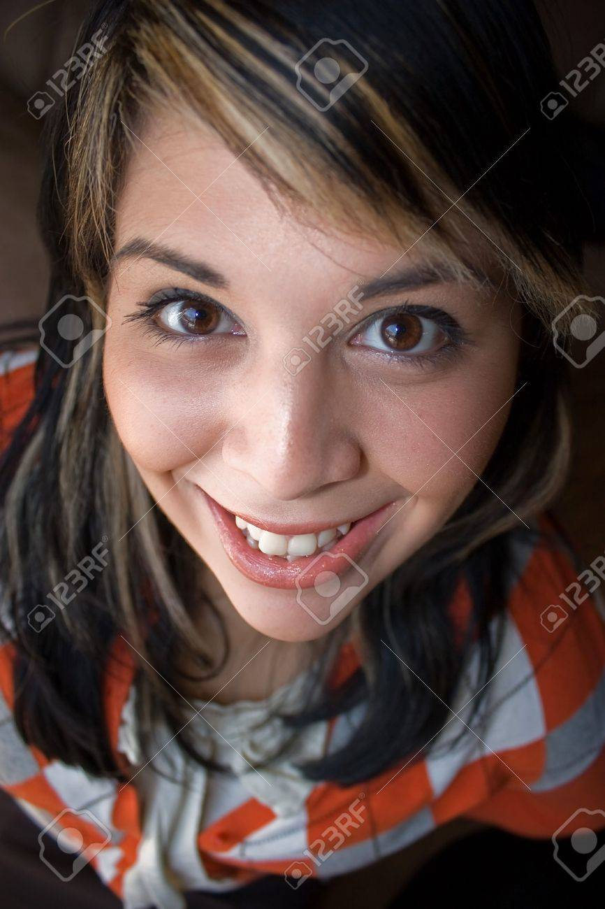Portrait of a happy young Spanish woman with blonde highlights in her hair. Stock Photo - 4762825