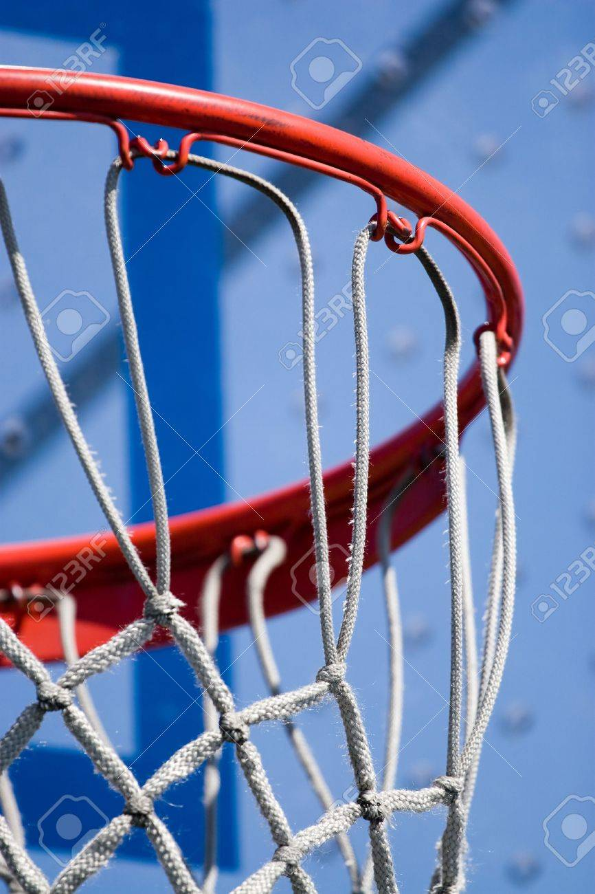 closeup detail of a playground basketball goal and net shallow