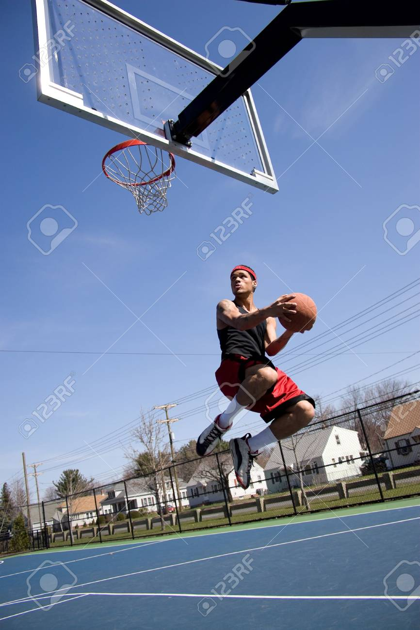 A young basketball player driving to the hoop with some fancy moves. Stock Photo - 4918068
