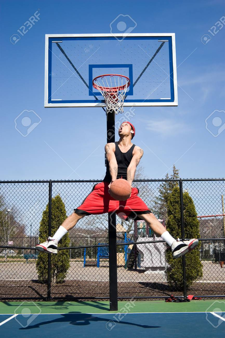 A young basketball player driving to the hoop with some fancy moves. Stock Photo - 5094528