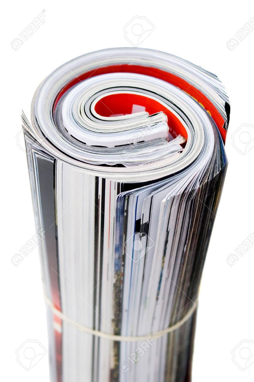 Rolled up magazines isolated over white. Shallow depth of field. Stock Photo - 5431809