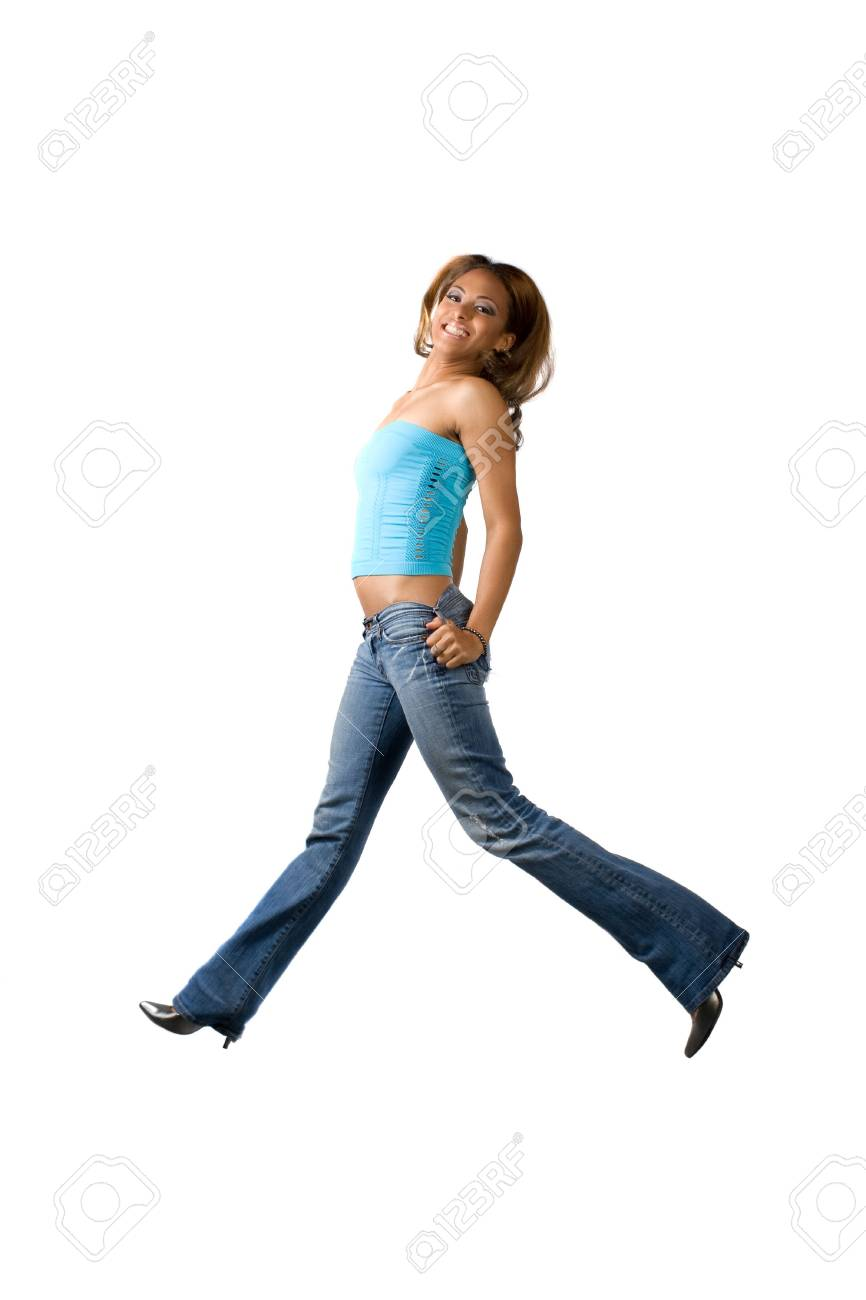 A young woman jumping on a white background. Stock Photo - 5469394