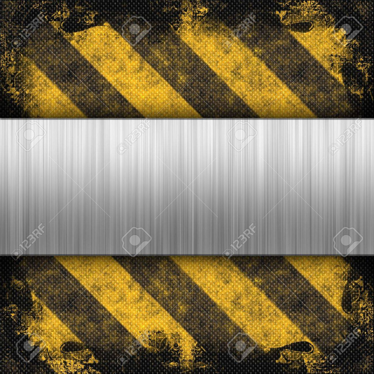 3d brushed metal layout on a grungy hazard stripes background.  This makes a great industrial layout.  The stripes have a carbon fiber look. Stock Photo - 6258522