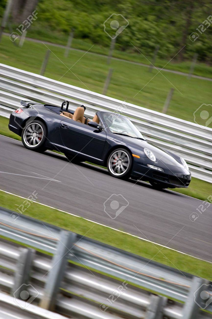 A sports car zooming down the road at intense speeds. Stock Photo - 6688003