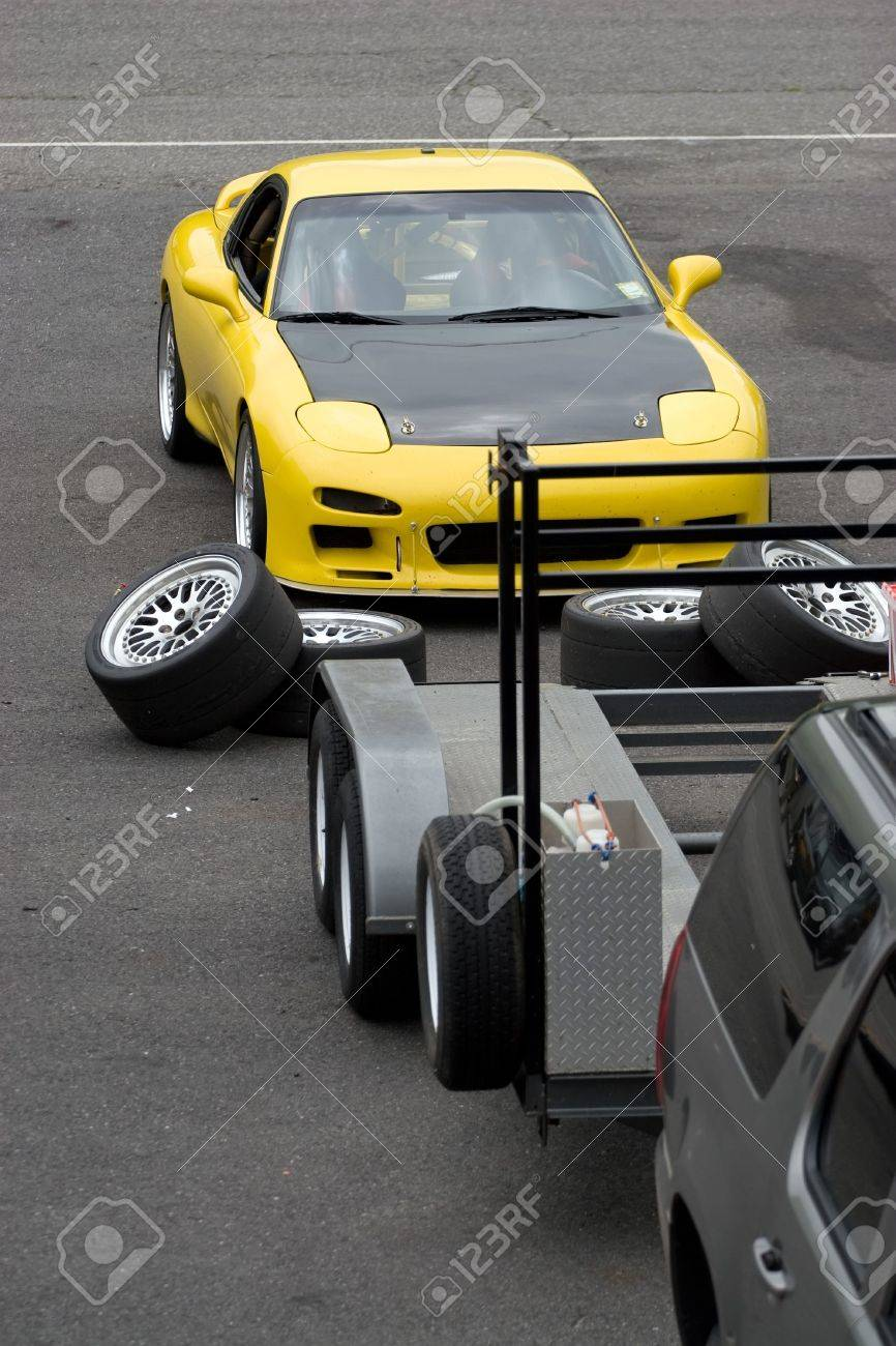 A yellow sports car in the race track pit area. Stock Photo - 6741214