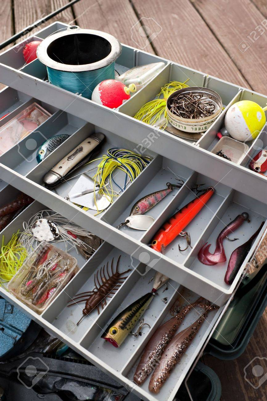 a fully stock fishermans tackle box fully stocked with lures, Fishing Reels