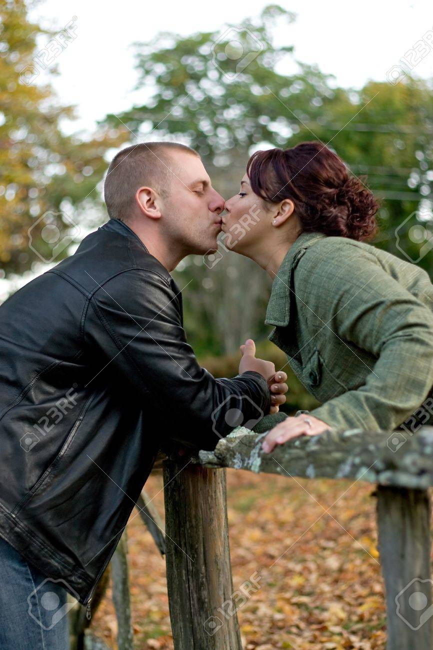 A young happy couple passionately kissing each other outdoors in the fall. Stock Photo - 6894337