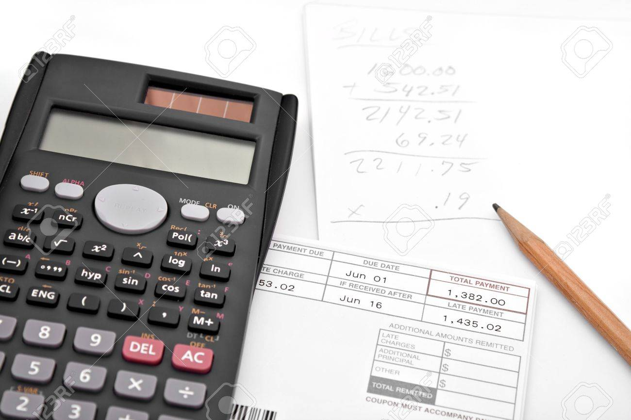 a calculator and papers for adding up the monthly bills isolated