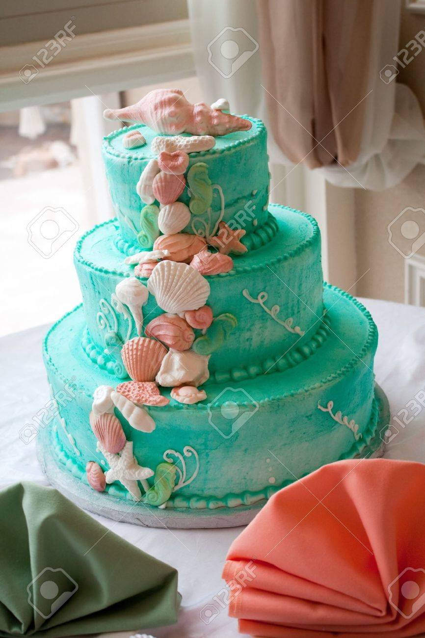 A Blue Beach Themed Wedding Cake With Three Tiers. Stock Photo   7794978