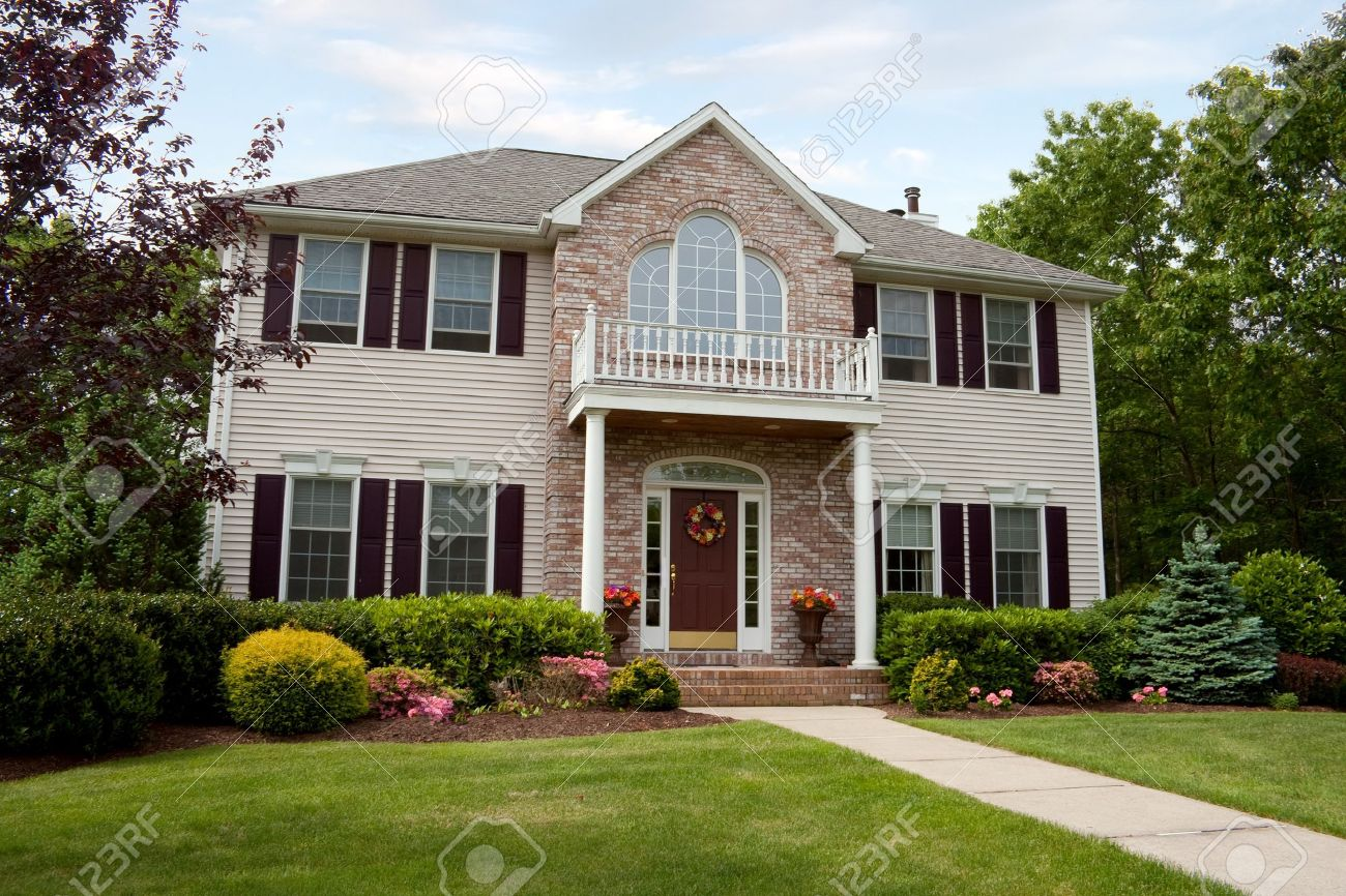 A modern custom built luxury home in a residential neighborhood.  This upper class home is a very nicely landscaped property. Stock Photo - 7795248