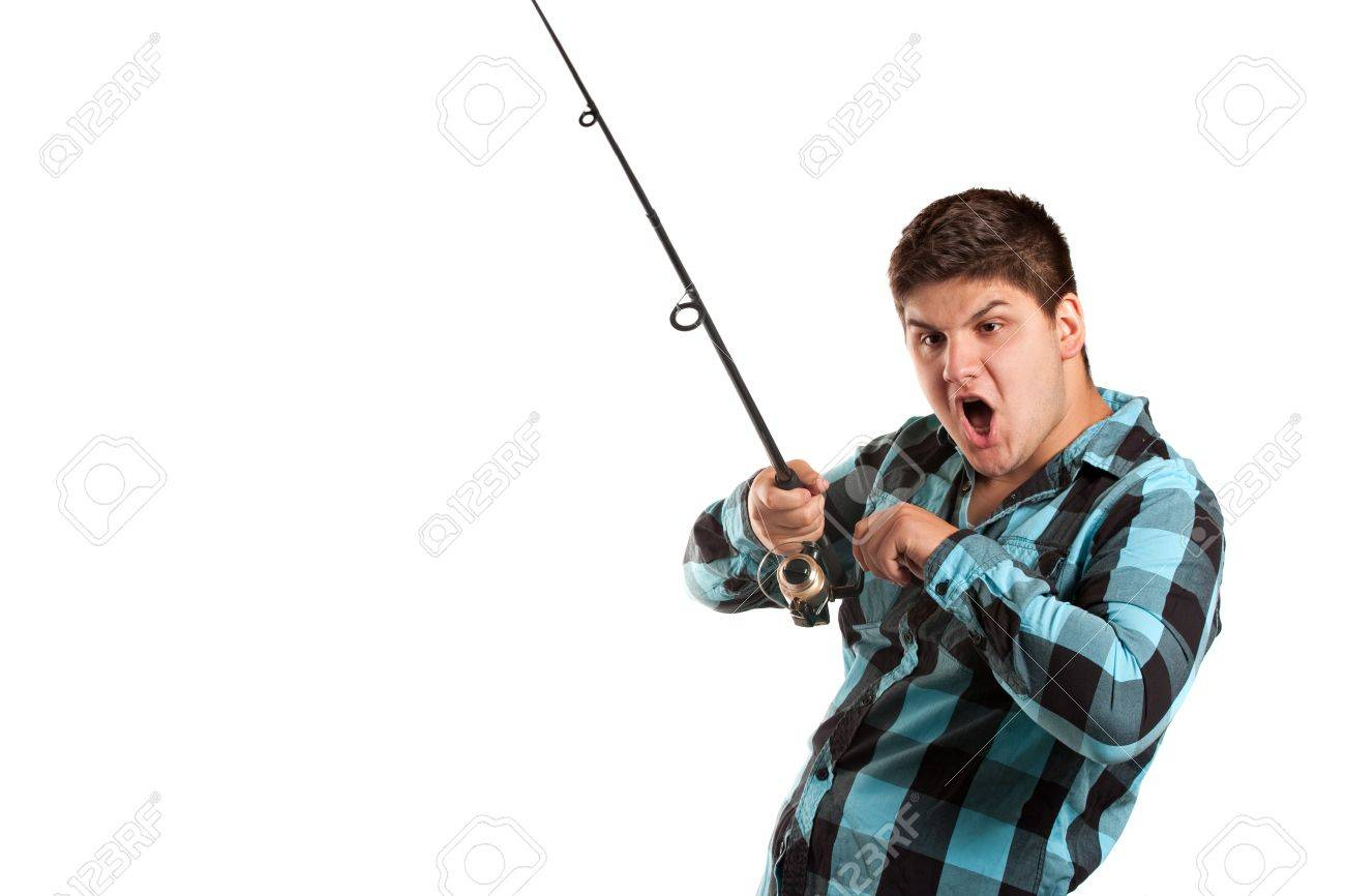 A teenager is surprised as he reels in a big fish.  Isolated over white in studio with plenty of negative space. Stock Photo - 7927602