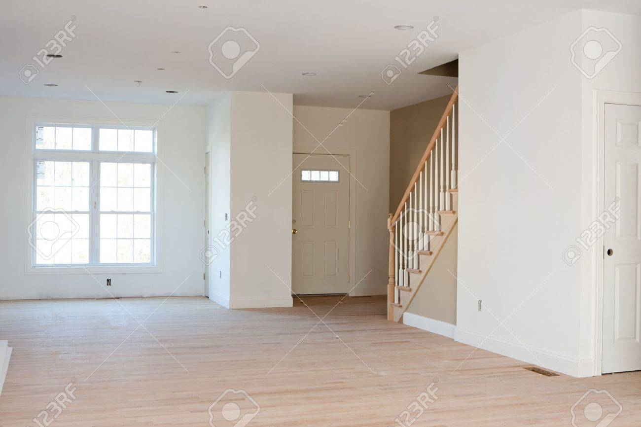 Brand new house construction interior room with unfinished wood floors. The  HVAC electrical outlets and - Brand New House Construction Interior Room With Unfinished Wood
