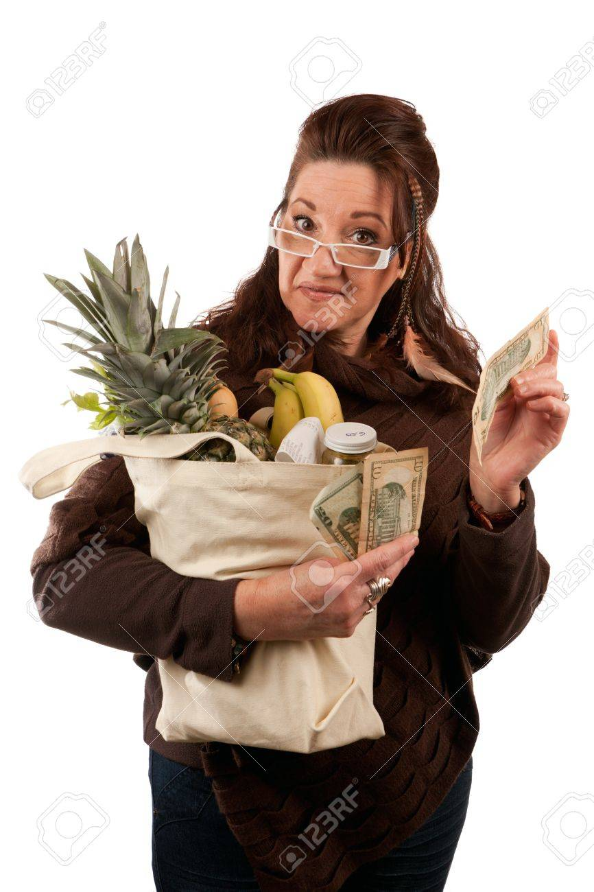 Middle aged female shopper smiling with a handful of cash acting proud of how much money she has saved on her grocery shopping bill. Stock Photo - 20309646