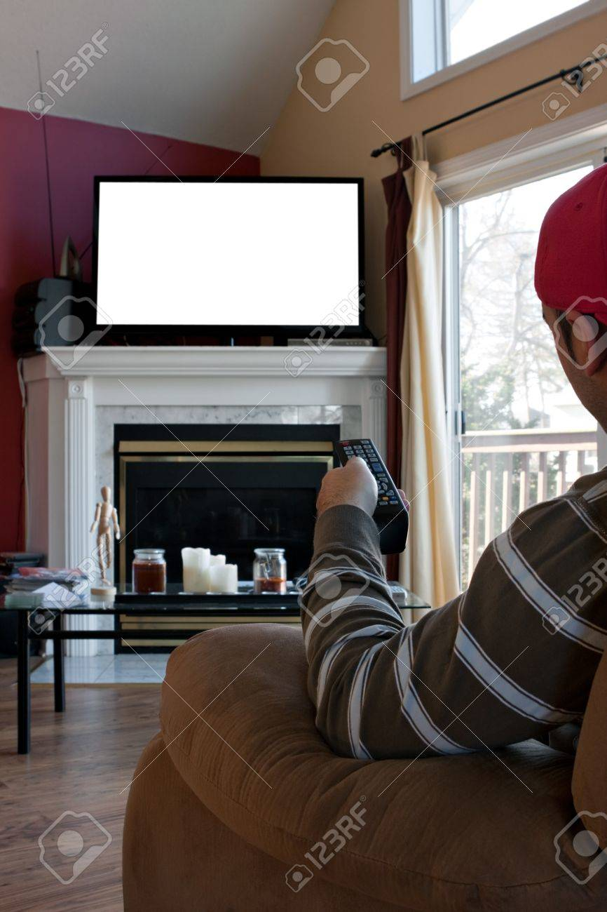 Bored Man Watches A Big Screen Flat Panel TV In His Living Room. Screen  Space Part 95