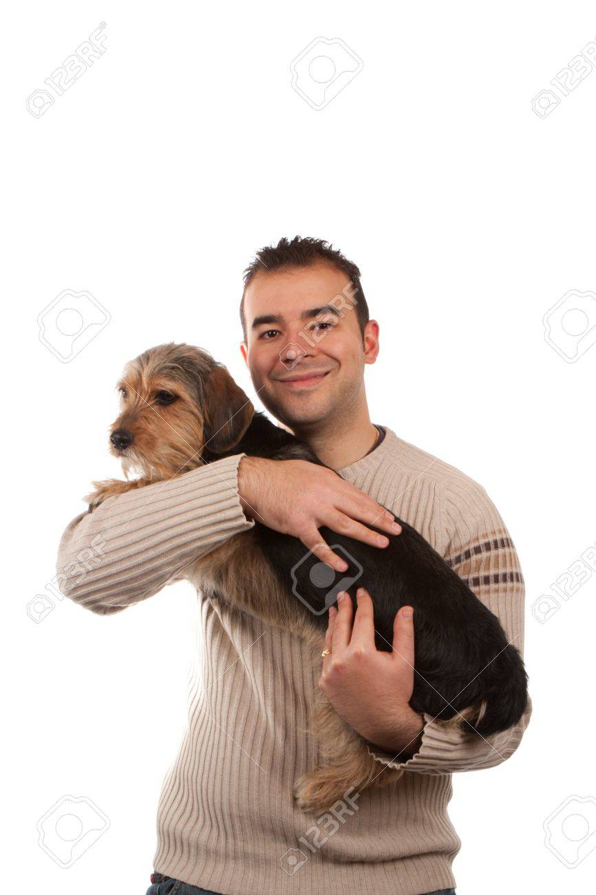 Portrait of a man holding a cute mixed breed dog isolated over white. Stock Photo - 13452917