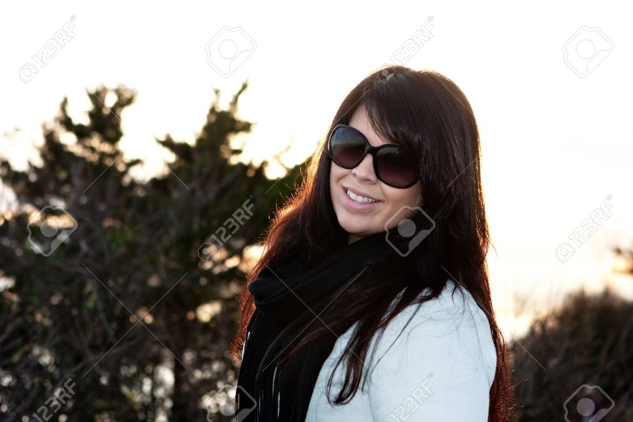 Portrait of an attractive brunette woman with intentional lens or sun flare. Stock Photo - 14179442