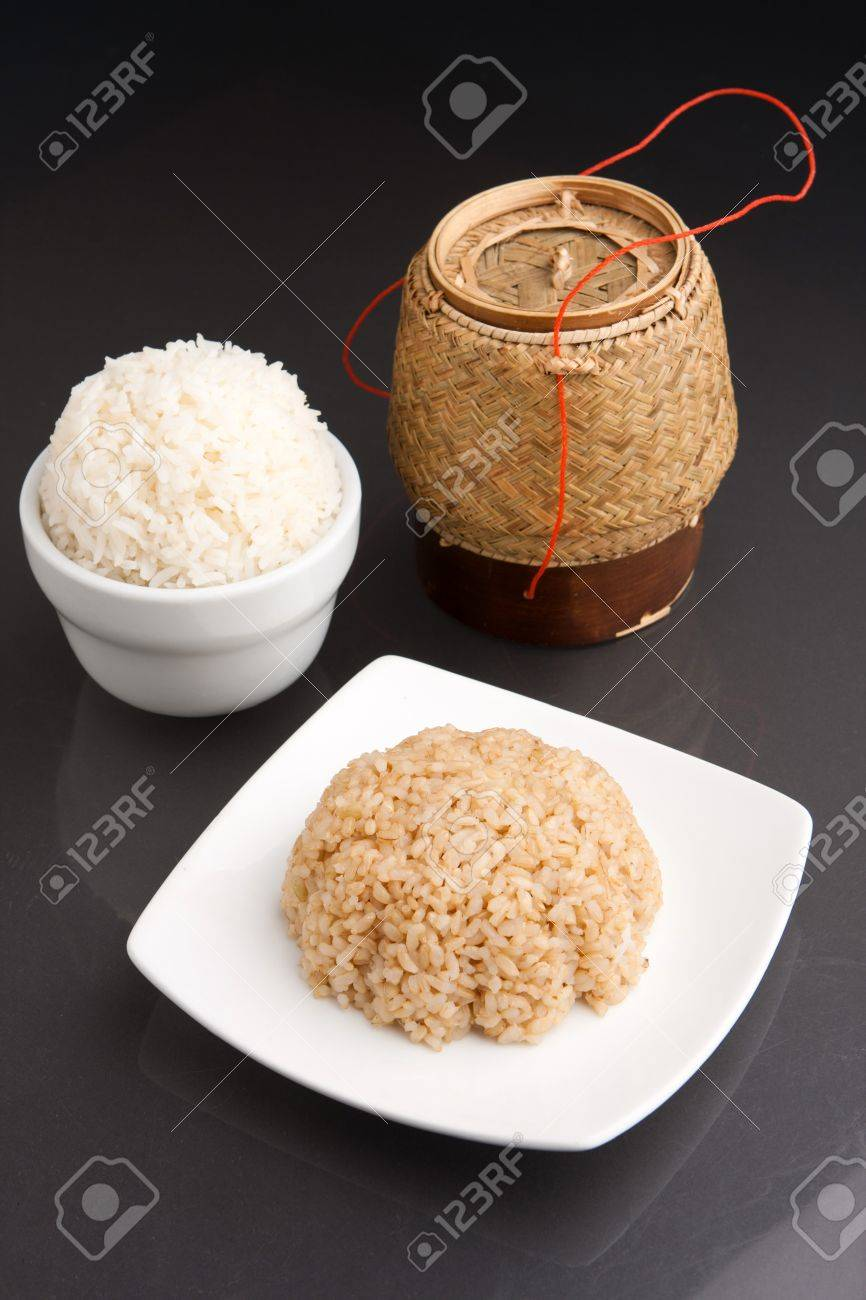 Different kinds of Thai style rices prepared including white jasmine and brown rice. Stock Photo - 18447084