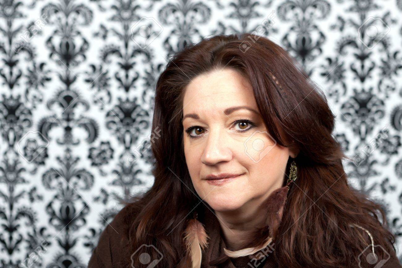 Brunette Middle Aged Woman With Feather Hair Extensions And