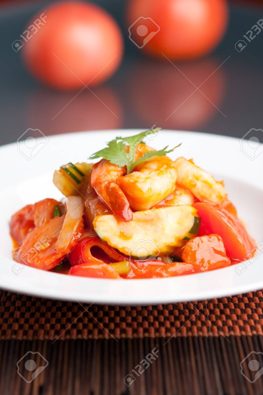 Thai style sweet and sour shrimp dish presented beautifully on a round white plate. Stock Photo - 20209254