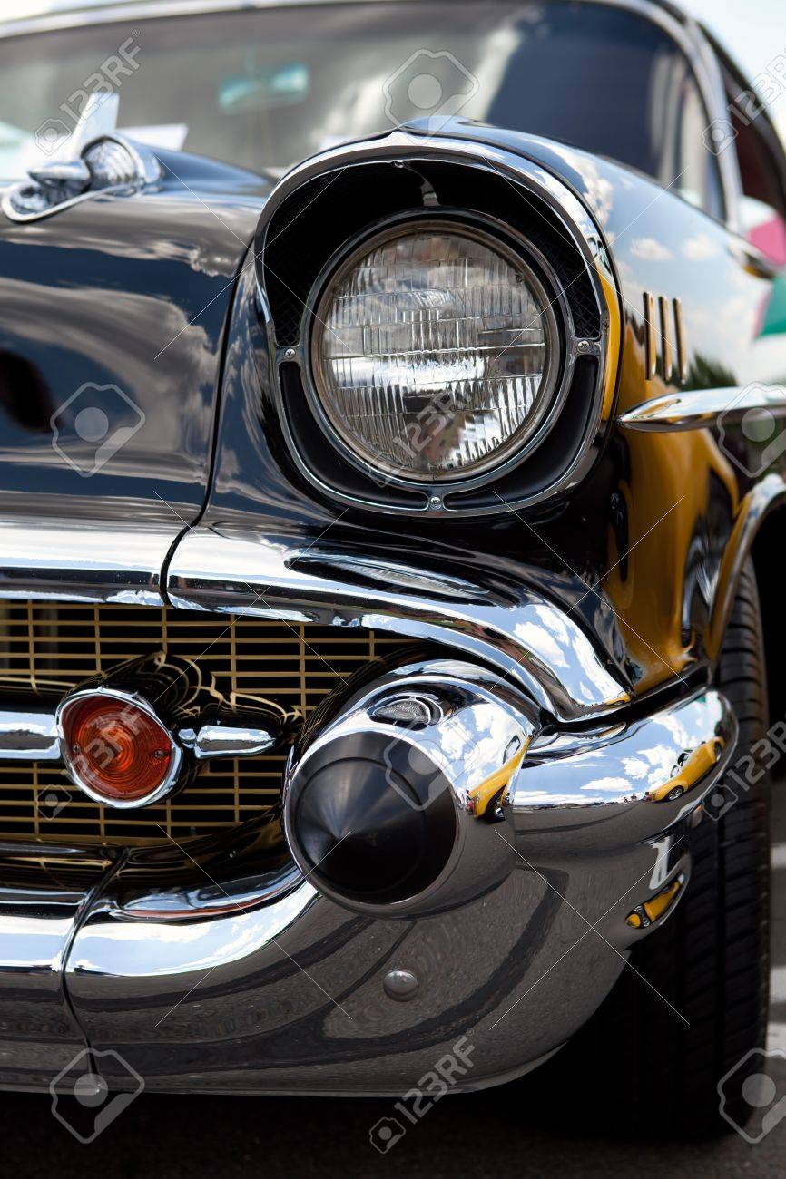 Design of a car bumper - A Closeup Of The Headlight And Front Bumper On A Vintage Car Stock Photo